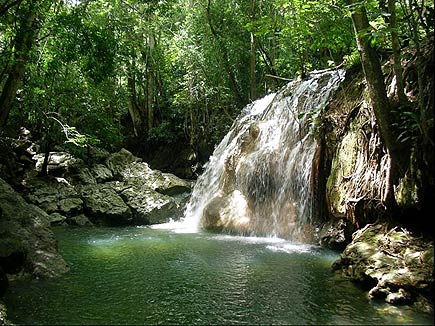 a hot waterfall in the rio dulce / lake izabal region of guatemala